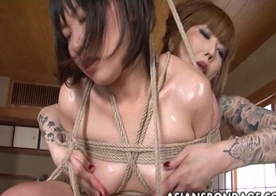Asian servitude floozy has her wet cunt fingered by a lesbian