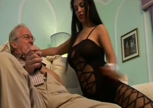 Gorgeous brunette in black stuff Cory Everson would love to ride old man's dick