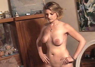 Horn-mad short haired sinful blonde tries to wank her pussy a bit on web camera