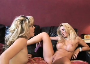 Lusty golden-haired lesbos with large titties experiment with some toys