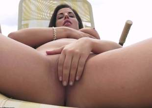 Marina Sweet is a busty brunette and she has some spare time on her hands so shes gonna fill it up with some pink sex tool action Time aint the only thing getting filled
