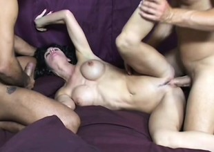 Breasty MILF enjoys having her holes torn apart in hardcore threesome