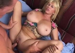Horny Penny Porsche licks her enormous boobs as she takes a nailing