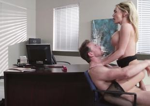 A hawt blonde is getting her pussy spread open in the office this day