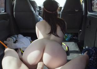 Youthful hippie chick riding his fantastic large dick in the car