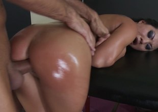 Oiled up slut is getting her hair pulled during her sexy scene
