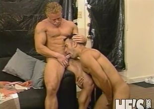 Two muscle studs take turns blowing on each others hard cocks in advance of they both explode their loads all over each others hot hard bodies!