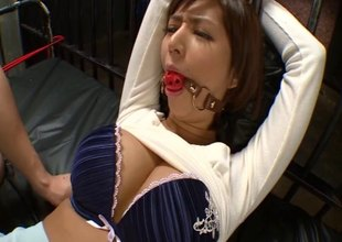 Asian slut in lingerie has her nipples pinched and mouth gagged
