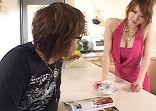 Brunette Japanese woman in a cute dress gives a blowjob