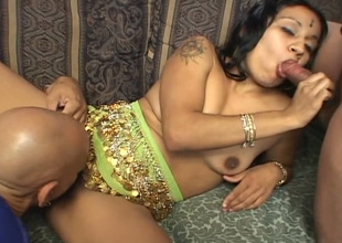 Bitchie Indian straight haired housewife works on two dicks at once