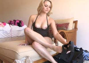Blonde in diabolical top removes her high heels and reaches out for vibrator