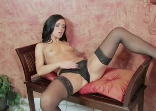 Brunette in stockings toys her cum-hole as she masturbates perfectly in a solo scene