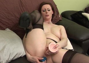 English housewife playing with a rubber sex toy