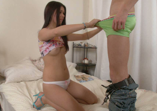 Sweet brunette gal sucks her fellow's sugary wang with great desire