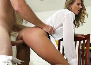Blonde turns guy on before giving cock rub-down