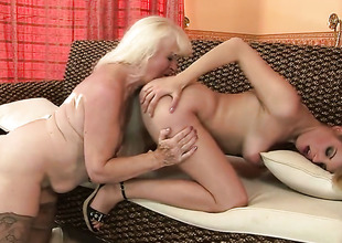 Tow-haired Laraan with gigantic jugs has some time to give some sexual pleasure to lesbo Mylen