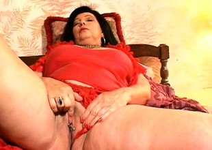 Chunky older woman plays with her nipples and fingers her needy twat
