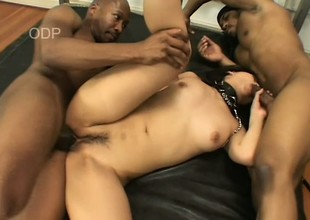 Naughty Japanese girl has two black guys roughly stretching her holes