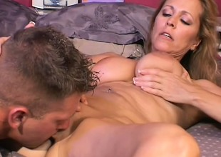 Captivating mature doxy is tasting the dick of tattooed gent
