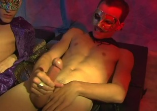 Jason Raze and Justin Case both stroke their large hard cocks for us at one's disposal a mascarade party. They stroke until they both discharge a sexy load of cum all over their chests and stomachs. Very sexy climax...