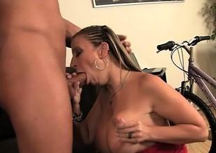Lusty blonde floosie with superb fake tits sucks delicious kielbasa