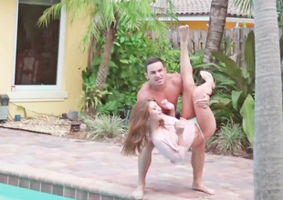 Brunette is thrown into the pool and then fucked