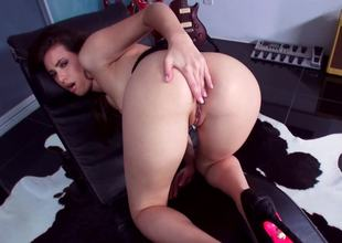 A hot bitch pushes a large dildo in her wet pussy in front of us