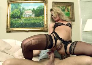 A sexy blonde with a good ass is getting roughly fucked in the but