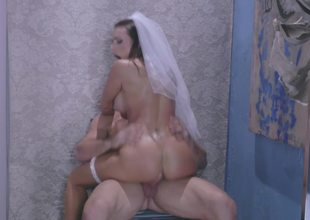 A sexy bride to be is getting fucked on the carpet by a man
