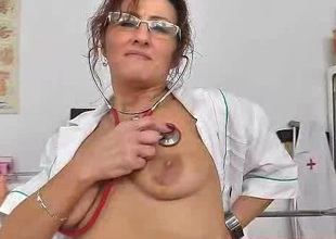 Mature European doctor dildoing herself in the sanatorium