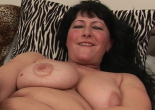 Horny mature slattern playing with her snatch
