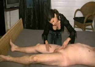 Dressed babe stroking that hard penis