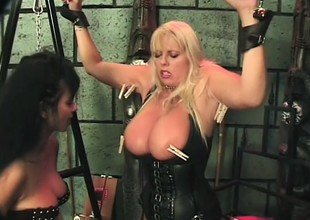 Engaging and fascinating blond hooker gets her big tits pinched