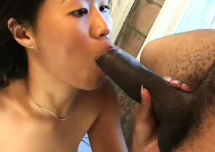 Filthy Oriental battle-axe has a nasty addiction to stiff black cock