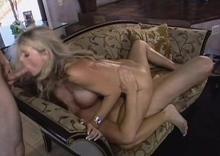 Sexy blond MILF with merry tits takes on two dueling dicks in a threesome