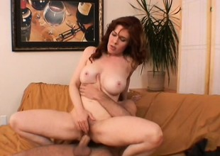 Slutty redhead longs for a huge throbbing dick right up her twat
