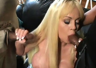 MILF gets two gigantic glowering dicks in the one and the other her holes at one's disposal one time