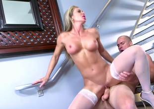 A milf is performing a blow job in front of the camera lens