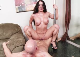 Slut with a stripper pole in her abode loves athletic fucking