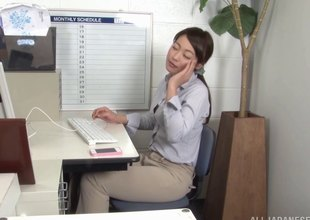 Clothed Japanese woman sucking a colleague's rod in the office