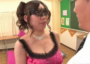Masked Japanese MILF with big tits on her knees sucking a cock