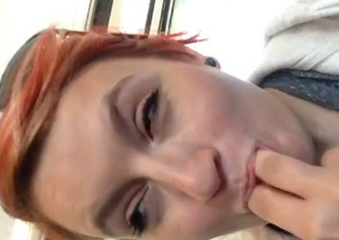 Nasty redhead plays with her vagina in a public bus