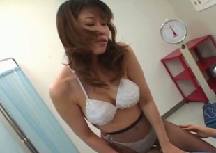Bosomy Japanese doctor treats her patient with awesome 69 sex