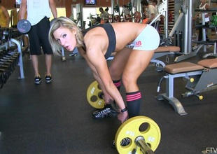 Flexible solo golden-haired with big tits masturbating in the gym