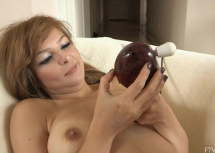 She turns on the powerful massager and lets it work her pussy