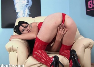 Babe in red outfit enjoys fingering and toy copulates her cunt