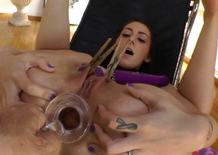 Brunette hair vixen takes a glass dildo unfathomable in her rectum