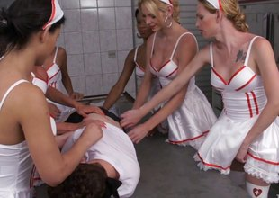 Hot ladyboy nurses teams up for a mesmerizing gang bang against their male colleague