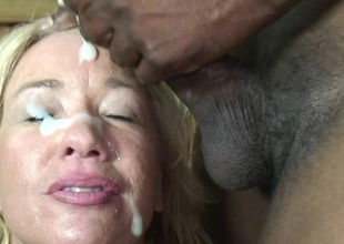 This golden-haired elderly slut just can't live without black cocks