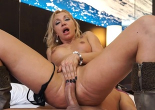Blonde MILF does a blowjob in public